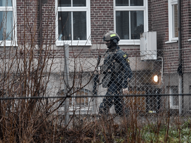 Police is seen outside Hassleholm Technical School in Haesselholm, Sweden after an explosion on December 20, 2018. - According to medias, a 20-year-old man has been arrested on suspicion of terrorism-related crimes. (Photo by Johan NILSSON / TT News Agency / AFP) / Sweden OUT (Photo credit should read JOHAN …