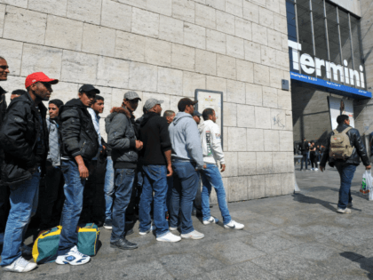 Tunisian would-be immigrants wait before boarding a train at Rome's Termini station to Ventimiglia, the Italian border town with France on April 21, 2011. Dozens out of the thousands who have fled from Tunisia to Italy by boat in recent weeks in the wake of the Jasmine Revolution in January …