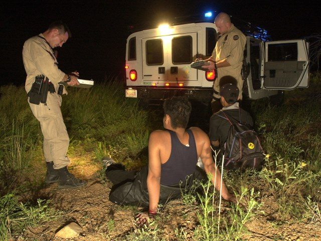 Border Patrol agents apprehend two illegal aliens.
