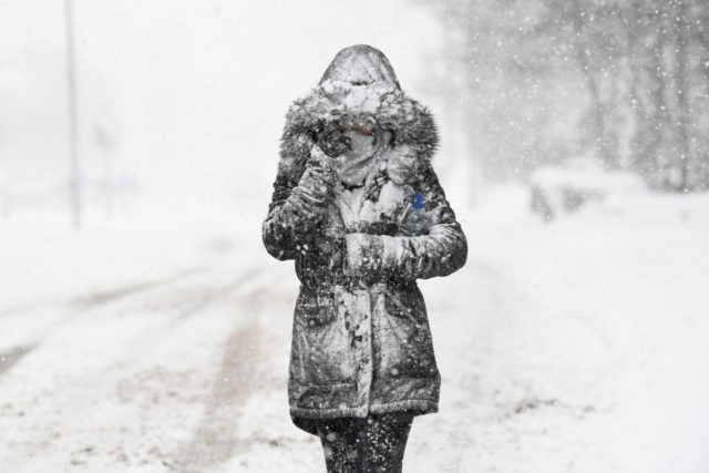 "BALLOCH, UNITED KINGDOM - MARCH 01: A woman makes her way through the snow on March 1, 2018 in Balloch, Scotland. Freezing weather conditions dubbed the ""Beast from the East"" combines with Storm Emma coming in from the South West of Britain to bring further snow and sub-zero temperatures causing …"