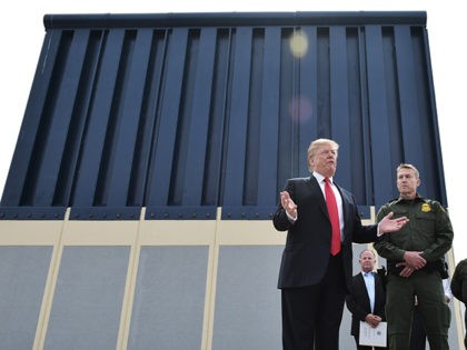 "US President Donald Trump speaks during an inspection of border wall prototypes in San Diego, California on March 13, 2018. Donald Trump -- making his first trip to California as president -- warned there would be ""bedlam"" without the controversial wall he wants to build on the border with Mexico, …"