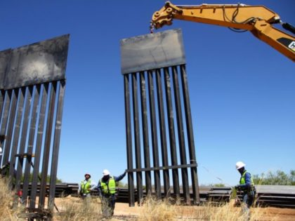 TOPSHOT - Workers replace an old section of the wall between the US and Mexico following orders by US President Donald Trump, in Santa Teresa, New Mexico State, US, close to Ciudad Juarez in Mexico's Chihuahua State, on April 23, 2018. (Photo by Herika MARTINEZ / AFP) (Photo credit should …