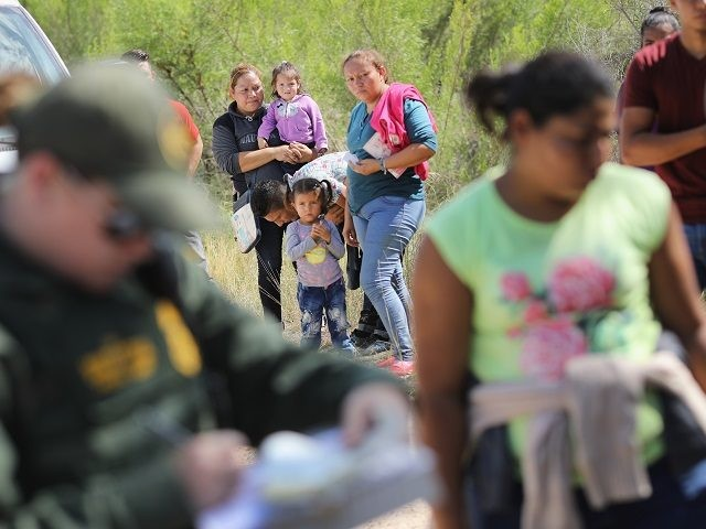 MCALLEN, TX - JUNE 12: Central American asylum seekers wait as U.S. Border Patrol agents take them into custody on June 12, 2018 near McAllen, Texas. The families were then sent to a U.S. Customs and Border Protection (CBP) processing center for possible separation. U.S. border authorities are executing the …