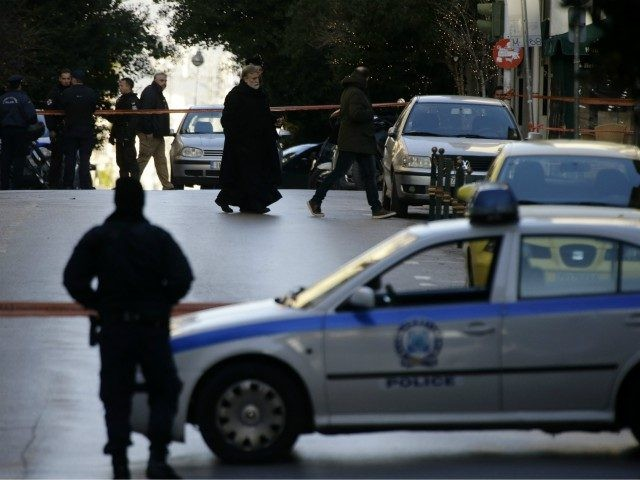 A Greek Orthodox priest arrives after an explosion at the Orthodox church of Agios Dionysios in the upscale Kolonaki area of Athens, Thursday, Dec. 27, 2018. Police in Greece say an officer has been injured in a small explosion outside a church in central Athens while responding to a call …
