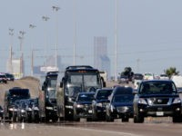 The motorcade carrying former President George H. W. Bush, travels to Ellington Air Force Base, Monday, Dec. 3, 2018, in Houston. (AP Photo/Michael Wyke)