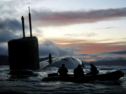 Observers watch the Royal Navy submarine HMS Talent conducting Dive and Surface Drills in the Kyle of Localsh, Scotland in 2009.