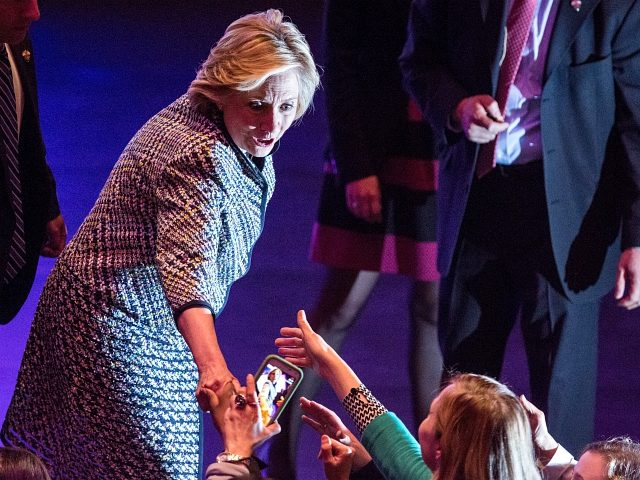 NEW YORK, NY - APRIL 23: Democratic presidential hopeful and former Secretary of State Hillary Clinton shakes hands with supporters after addressing the Women in the World Conference on April 23, 2015 in New York City. Clinton is in New York City after visiting Iowa and New Hampshire. (Photo by …