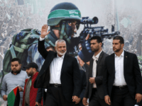 Gaza Hamas leader Ismail Haniya (3rd-R) waves upon his arrival at a rally marking the 31st anniversary of Hamas' founding, in Gaza City December 16, 2018. (Photo by SAID KHATIB / AFP) (Photo credit should read SAID KHATIB/AFP/Getty Images)