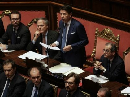 Italian Premier Giuseppe Conte delivers his speech on the budget law at the Senate, in Rome, Wednesday, Dec. 19, 2018. The European Commission says it has reached an agreement with Italy to avert legal action over the country's budget plans, which the EU's executive arm had warned could break euro …