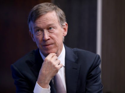 Colorado Gov. John Hickenlooper participates in a discussion as part of the Brookings Institution's Middle Class Initiative October 10, 2018 in Washington, DC. Hickenlooper, a Democrat, and Ohio Gov. John Kasich, a Republican, participated in the discussion and found common ground on issues related to the economy, trade, education and …