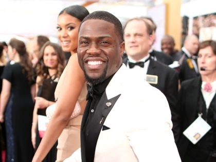 HOLLYWOOD, CA - FEBRUARY 22: Actor Kevin Hart (R) and Eniko Parrish attend the 87th Annual Academy Awards at Hollywood & Highland Center on February 22, 2015 in Hollywood, California. (Photo by Christopher Polk/Getty Images)
