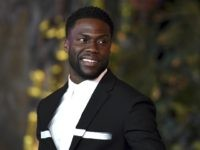 """Kevin Hart arrives at the Los Angeles premiere of """"Jumanji: Welcome to the Jungle"""" on Monday, Dec. 11, 2017 in Hollywood, Calif. (Photo by Jordan Strauss/Invision/AP)"""