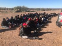 Large group of aliens sitting down after being apprehended near the US-Mexico border in Arizona. (Photo: U.S. Border Patrol/Tucson Sector)