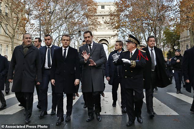 France's President Emmanuel Macron, centre left, France's Interior Minister Christophe Castaner, center, Secretary of State to the Interior Minister Laurent Nunez, left, and Paris police Prefect Michel Delpuech, right, arrive to visit firefighters and riot police officers the day after a demonstration, in Paris, Sunday, Dec. 2, 2018. A protest against rising taxes and the high cost of living turned into a riot in the French capital, as activists torched cars, smashed windows, looted stores and tagged the Arc de Triomphe with multi-colored graffiti. (AP Photo/Thibault Camus)