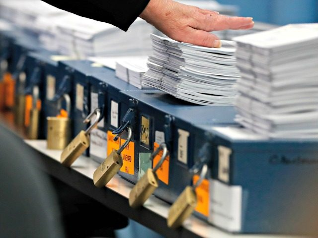 Ballots are prepared to be tabulated for Maine's Second Congressional District's House election Monday, Nov. 12, 2018, in Augusta, Maine. The election is the first congressional race in American history to be decided by the ranked-choice voting method that allows second choices.