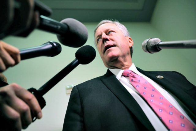 House Oversight and Government Reform Committee member Rep. Mark Meadows (R-NC) talks with reporters in the Rayburn House Office Building on Capitol Hill October 19, 2018 in Washington, DC. Meadows, who is the chairman of the House Freedom Caucus, has been leading the charge of misconduct against officials involved in …