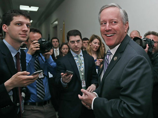 "House Freedom Caucus Chairman Rep. Mark Meadows, R-N.C. smiles as he speaks with the media on Capitol Hill in Washington, Thursday, March 23, 2017, following a Freedom Caucus meeting. GOP House leaders delayed their planned vote on a long-promised bill to repeal and replace ""Obamacare,"" in a stinging setback for …"