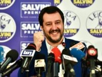 Lega far right party leader Matteo Salvini (C) smiles and rises his fist at the Lega headquarter in Milan on March 5, 2018 for a press conference ahead of the Italy's general election results. A surge for populist and far-right parties in Italy's weekend election could result in a hung …