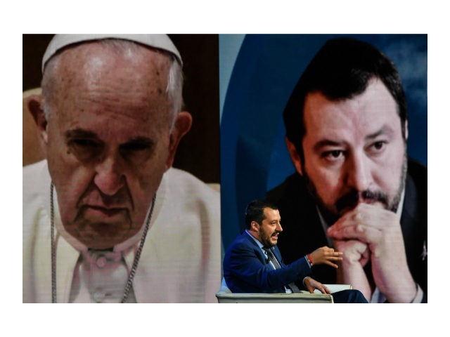 Italys Interior Minister and Deputy Prime Minister Matteo Salvini gestures as he speaks during the Italian talk show 'Porta a Porta', broadcast on Italian channel Rai 1, in Rome, on June 20, 2018, as a picture of Pope Francis is seen in the background. (Photo by Andreas SOLARO / AFP) …