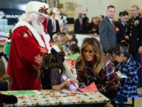 US First Lady Melania Trump attends with Father Christmas personificator a Toys for Tots event at Joint Base Anacostia-Bolling in Washington, DC, on December 11, 2018. - Toys for Tots is a program run by the United States Marine Corps Reserve which distributes toys to children whose parents cannot afford …
