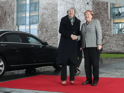 WATCH: Merkel Looks on as Brit PM Locked in Car Ahead of Crunch Talks