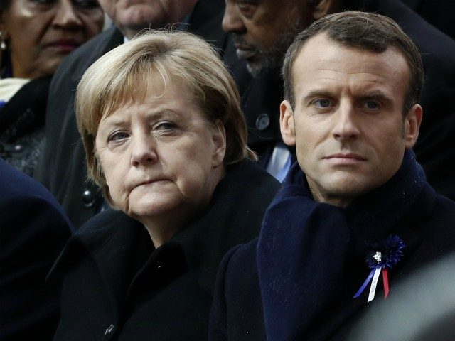 German Chancellor Angela Merkel (L) and French President Emmanuel Macron attend a ceremony at the Arc de Triomphe in Paris on November 11, 2018 as part of commemorations marking the 100th anniversary of the 11 November 1918 armistice, ending World War I. (Photo by BENOIT TESSIER / POOL / AFP) …