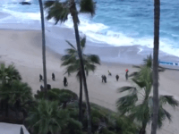 Migrants make U.S. landfall in a panga boat at Laguna Beach, CA. (Photo: Laguna Beach Police Department Video Screenshot)