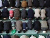 LONDON, ENGLAND - FEBRUARY 18: Muslim men pray at Baitul Futuh Mosque in Morden on February 18, 2011 in London, England. Around five thousand Muslim men and women converged at the mosque today, which is Western Europe's largest, to Unite against Extremism and pay vigil following a series of sectarian …
