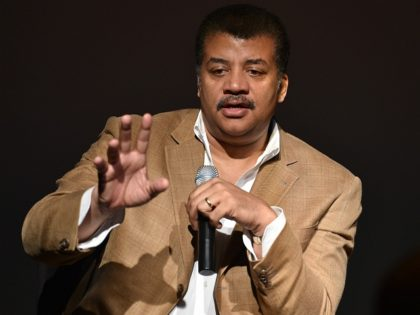 Neil deGrasse Tyson, astrophysicist, 'Cosmos' television show host and Frederick P. Rose Director of the Hayden Planetarium at the American Museum of Natural History speaks August 4, 2014 after a screening of James Cameron's 'Deepsea Challenge 3D' film at the museum in New York. AFP PHOTO/Stan HONDA (Photo credit should …