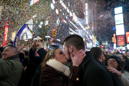 Kaitlin Olivi of Yonkers, N.Y., and Lucas Pereira, of Sayreville, N.J., kiss as confetti falls during a celebration of the new year in New York's Times Square, Sunday, Jan. 1, 2017.