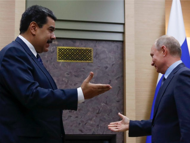 Russian President Vladimir Putin (R) meets with his Venezuelan counterpart Nicolas Maduro at the Novo-Ogaryovo state residence outside Moscow on December 5, 2018. (Photo by MAXIM SHEMETOV / POOL / AFP) (Photo credit should read MAXIM SHEMETOV/AFP/Getty Images)