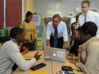 US President Barack Obama chats with students during a visit to a classroom at Pathways in Technology Early College High School, in Brooklyn, New York on October 25, 2013. AFP PHOTO/Mandel NGAN (Photo credit should read MANDEL NGAN/AFP/Getty Images)