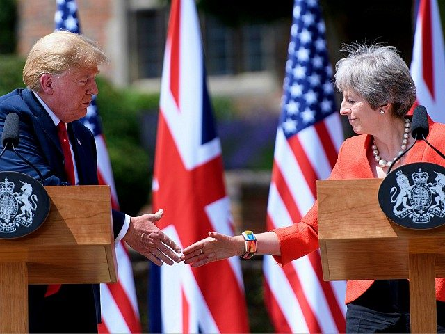 US President Donald Trump (L) and Britain's Prime Minister Theresa May shake hands during a joint press conference following their meeting at Chequers, the prime minister's country residence, near Ellesborough, northwest of London on July 13, 2018 on the second day of Trump's UK visit. - Britain and the United …