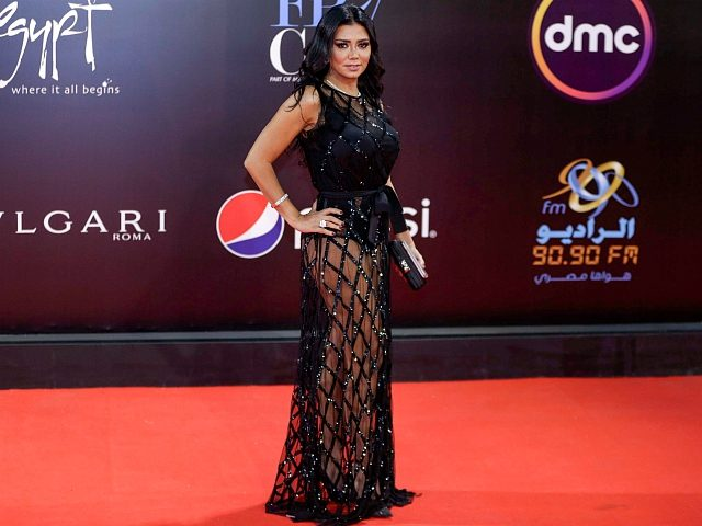 Egyptian actress Rania Youssef poses on the red carpet at the closing ceremony of the 40th edition of the Cairo International Film Festival (CIFF) at the Cairo Opera House in the Egyptian capital on November 29, 2018. - Youssef is to face trial in January 2019 for appearing at the …