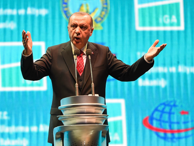 Turkey's President Recep Tayyip Erdogan speaks at the official opening ceremony of Istanbul's new airport (Istanbul Yeni Havalimani) on October 29, 2018 in Istanbul, Turkey. New mega-hubs first phase includes two runways, a terminal and is expected to have an annual passenger capacity of 90 million. Once all four phases …