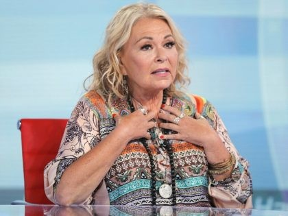 """Roseanne Barr talks with Fox News talk show host Sean Hannity while being interviewed during a taping of his show, Thursday, July 26, 2018, in New York. The comedian and actress will appear on the Fox News show """"Hannity"""" on Thursday at 9 p.m. EDT for the first time since …"""