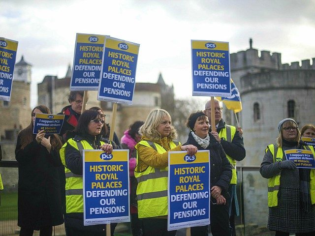 People at the Tower of London on the picket line as staff from Royal Palaces take industrial action over pay. Friday, Dec. 21, 2018. The strikers carried placards but did not close the popular tourist attraction. There were also strikers outside Hampton Court Palace and Kensington Palace, which both remained …