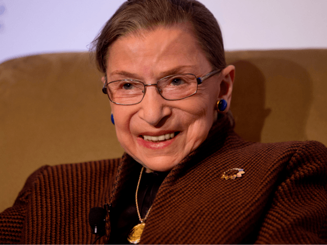 In this Dec. 17, 2013 file photo, Supreme Court Justice Ruth Bader Ginsburg smiles while speaking to the Northern Virginia Technology Council in Reston, Va. A Supreme Court spokeswoman says Justice Ruth Bader Ginsburg has been released from the hospital after having a heart stent implanted to clear a blocked …