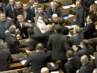 Ukrainian lawmakers broke out into a massive brawl Thursday during a parliamentary session, continuing a long-held tradition of throwing punches at each other over the issues of the day.