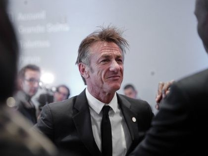 US actor Sean Penn speaks with Haiti's President Jovenel Moise at the One Planet Summit, in Boulogne-Billancourt, near Paris, France, Tuesday, Dec. 12, 2017. World leaders, investment funds and energy magnates promised to devote new money and technology to slow global warming at a summit in Paris that President Emmanuel …