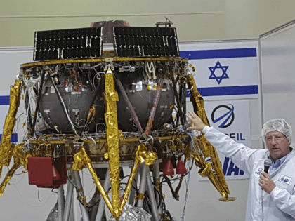 "Opher Doron, general manager of Israel Aerospace Industries' space division, speaks beside the SpaceIL lunar module, in a special ""clean room"" where the space craft is being developed, during a press tour of their facility near Tel Aviv, Israel, Tuesday, July 10, 2018. SpaceIL and the state-owned Israel Aerospace Industries …"