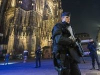 STRASBOURG, FRANCE - DECEMBER 12: Police officers patrol in front of the cathedral near the Christmas market where the day before a man shot 14 people, killing at least three, on December 12, 2018 in Strasbourg, France. Police have identified the man as Cherif Chekatt, a French citizen on a …
