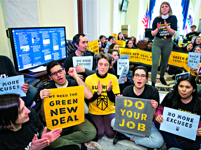 Environmental activists occupy the office of House Democratic Leader Nancy Pelosi of California, the speaker-designate for the new Congress, as they try to pressure Democratic support for a sweeping agenda to fight climate change, on Capitol Hill in Washington, Monday, Dec. 10, 2018.