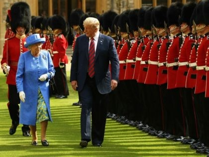 WINDSOR, ENGLAND - JULY 13: U.S. President Donald Trump and Britain's Queen Elizabeth II inspect a Guard of Honour, formed of the Coldstream Guards at Windsor Castle on July 13, 2018 in Windsor, England. Her Majesty welcomed the President and Mrs Trump at the dais in the Quadrangle of the …