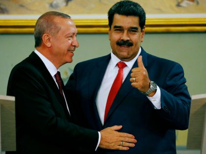Venezuela's President Nicolas Maduro gives a thumbs up next to Turkey's President Recep Tayyip Erdogan after a joint press conference at Miraflores presidential palace in Caracas, Venezuela, Monday, Dec. 3, 2018. Recep Tayyip Erdogan is on a one-day official visit after attending the G20 in Argentina. (AP Photo/Ariana Cubillos)