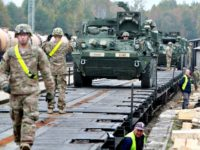 Members of the US Army 1st Brigade, 1st Cavalry Division, unload Stryker Armored Vehicles at the railway station near the Rukla military base in Lithuania, on October 4, 2014. Lithuania will increase its defence budget by a third next year amid concerns over a resurgent Russia, but spending will still …