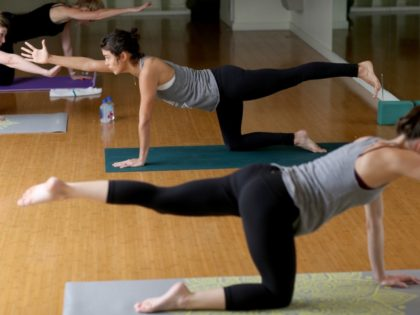 women practicing in a Yoga studio