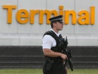 LONDON - JULY 03: An armed police officer stands guard at Terminal 4, Heathrow Airport on July 3, 2007 in London, England. Officials at Heathrow Terminal 4 have confirmed they have a suspect bag which has caused major disruption to the travel network. (Photo by Daniel Berehulak/Getty Images)