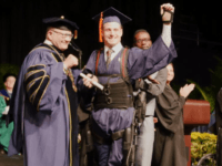 Aldo Amenta, who graduated from Florida International University (FIU), walked across the stage to fetch his diploma from school officials, thanks to a little support from an exoskeleton.