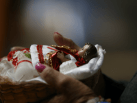 "A woman takes her baby Jesus figurine to the altar to be blessed, inside the San Juan Bautista Parish, on ""Dia de la Candelaria"" or Candlemas Day, in Mexico City, Friday, Feb. 2, 2018. According to Christian tradition, Candlemas marks Mary and Joseph's presentation of the baby Jesus in the …"